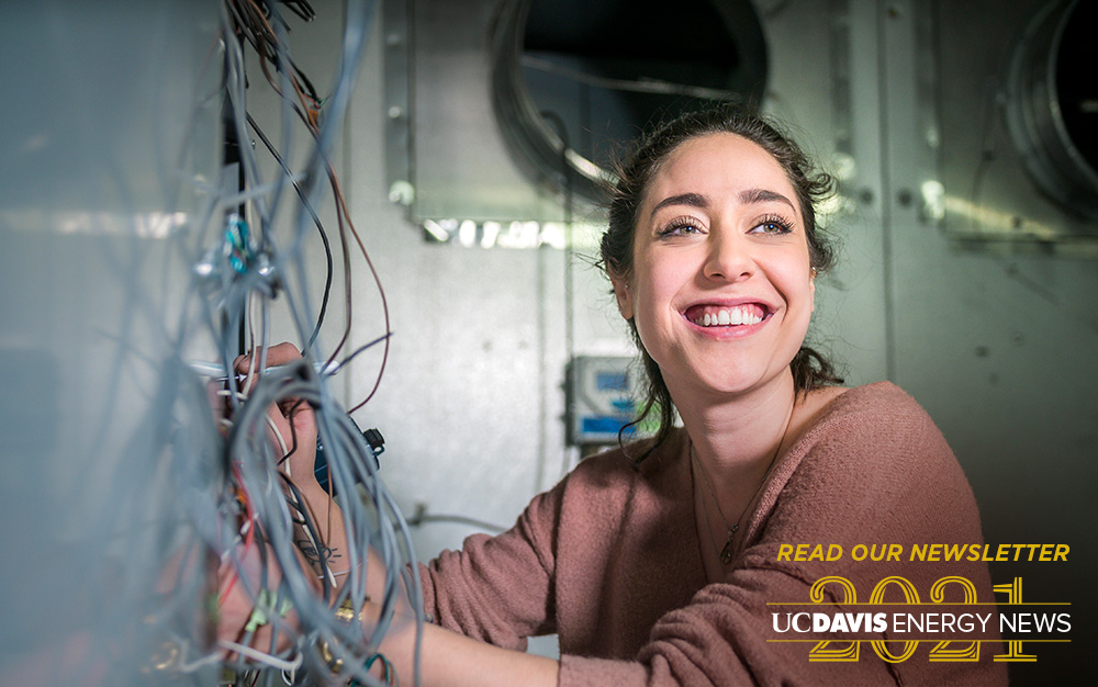 Newsletter page button image of young woman working in an HVAC laboratory environment chamber